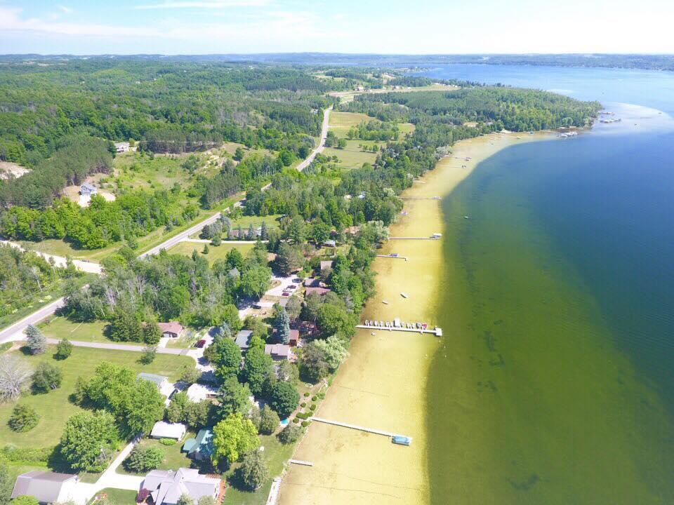 sandy beach shoreline lake leelanau